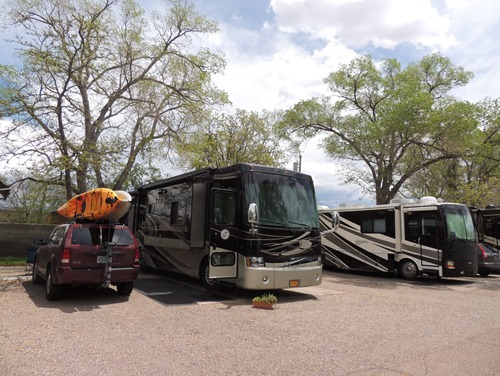 Our site at Trailer Ranch RV Resort. There is a picnic table and grassy area behind the Jeep