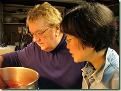 Sandra and Masami stirring pot