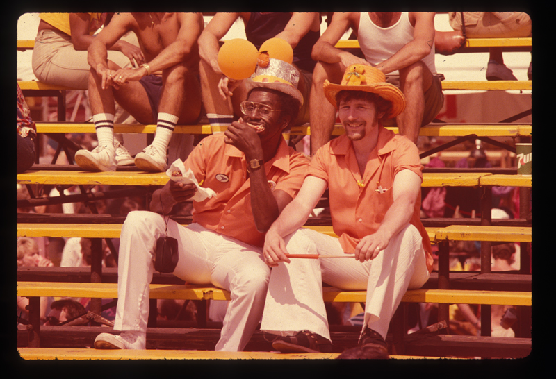 A couple in matching attire at the Los Angeles Christopher Street West pride parade. 1982.