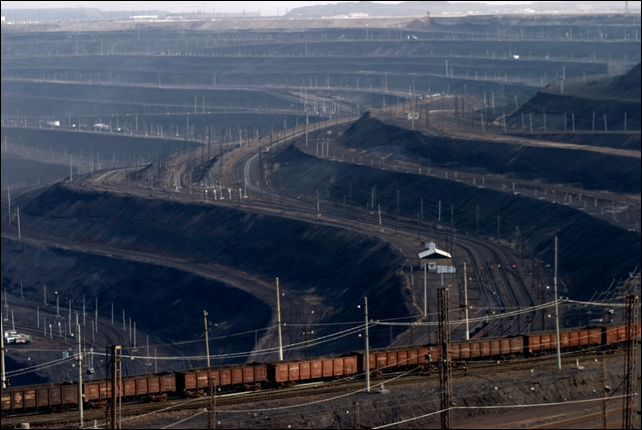 Train transporting coal out of an open pit coal mine in Ekibastuz, Kazakhstan, one of the largest open pit coal mines in the world, operated by Bogatyr Access Komyr. Photo: Christopher Herwig / Kod 9266