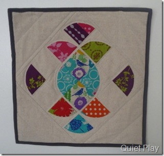 Ornate mini quilt in Echino and linen