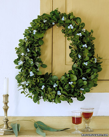 Traditional mistletoe is used in a new way by molding it into a wreath.