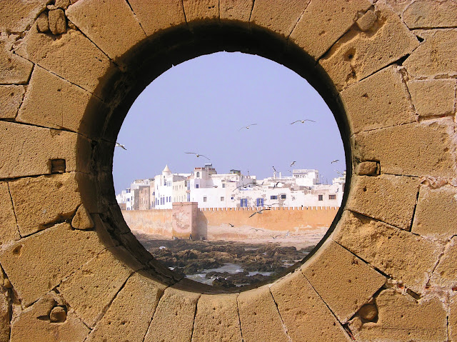 View of Essaouira, Morocco through the old Portuguese ramparts with seagulls.