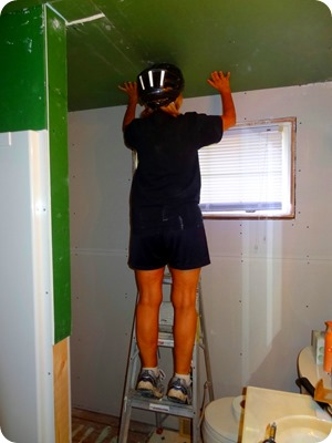marsha holding drywall