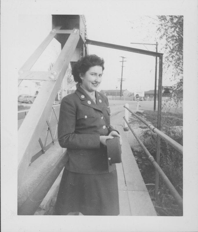 "Esther Herbert in uniform on ""THE"" bridge possibly in Long Beach, California. Circa 1944-1945."