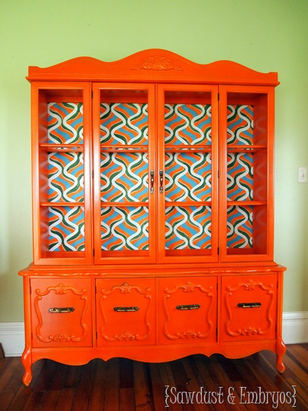 A retro orange china cabinet with hand-painted backboard is an excellent example of a DIY we sold.