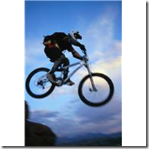 Mountain Biker Jumping Cliff ca. 2002