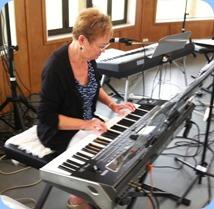 Diane Lyons having 'second helpings' on Gordon Sutherland's Korg Pa3X. Photo courtesy of Michael Bramley