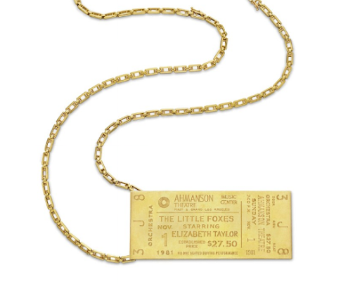 A Gold Pendant by Cartier. Designed as an 18k gold commemorative Broadway ticket for