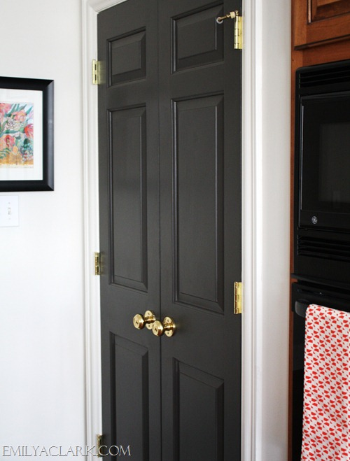 painted gray doors with brass knobs