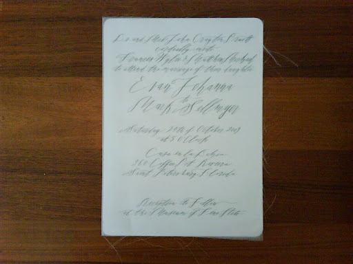 Here, the invite shown with the sheer fabric that wrapped around it.