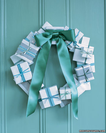 Wrap small boxes to create this festive wreath. Change the colors of the wrapping and ribbon to go with your own home's decor.