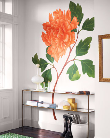 One bold print can make more of an impact than a repeat pattern. This larger-than-life botanical print (an enormous wall decal) is a clever way to add pattern to the walls.