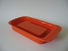 "orange soap dish, measures 7-1/2"" length"