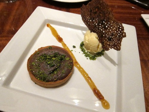 Dark chocolate soufflé tartlet, Orange marmalade, star anis ice cream