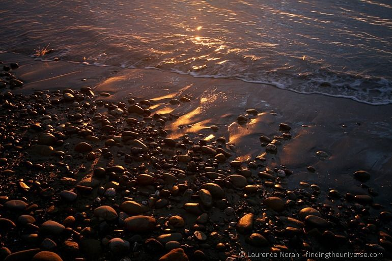 Sunrise beach pebbles
