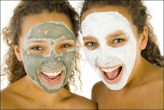 Happy girls with puryfying masks