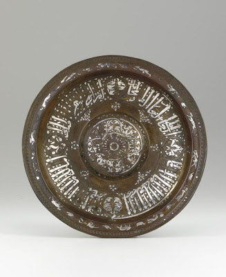 Plate | Origin:  Egypt | Period: mid-14th century  Mamluk period | Details:  Not Available | Type: Brass, inlaid with silver and gold | Size: H: 3.2  W: 28.9  cm | Museum Code: F1953.89 | Photograph and description taken from Freer and the Sackler (Smithsonian) Museums.