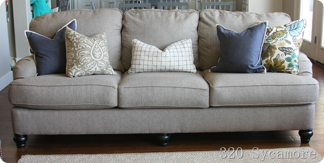 neutral sofa with colorful pillows