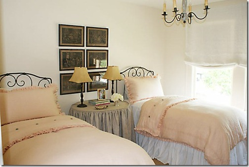 jane wood interiors pink linen twin beds and black matted artwork