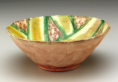 Bowl | Origin:  Nishapur,  Iran | Period: 10th century | Details:  Not Available | Type: Earthenware painted and incised under glaze | Size: H: 8.3  W: 21.1   D: 21.1  cm | Museum Code: S1997.128 | Photograph and description taken from Freer and the Sackler (Smithsonian) Museums.