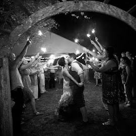 One last kiss by Brett Fox - Wedding Reception ( queer, wedding, arbor, brides, sparklers )
