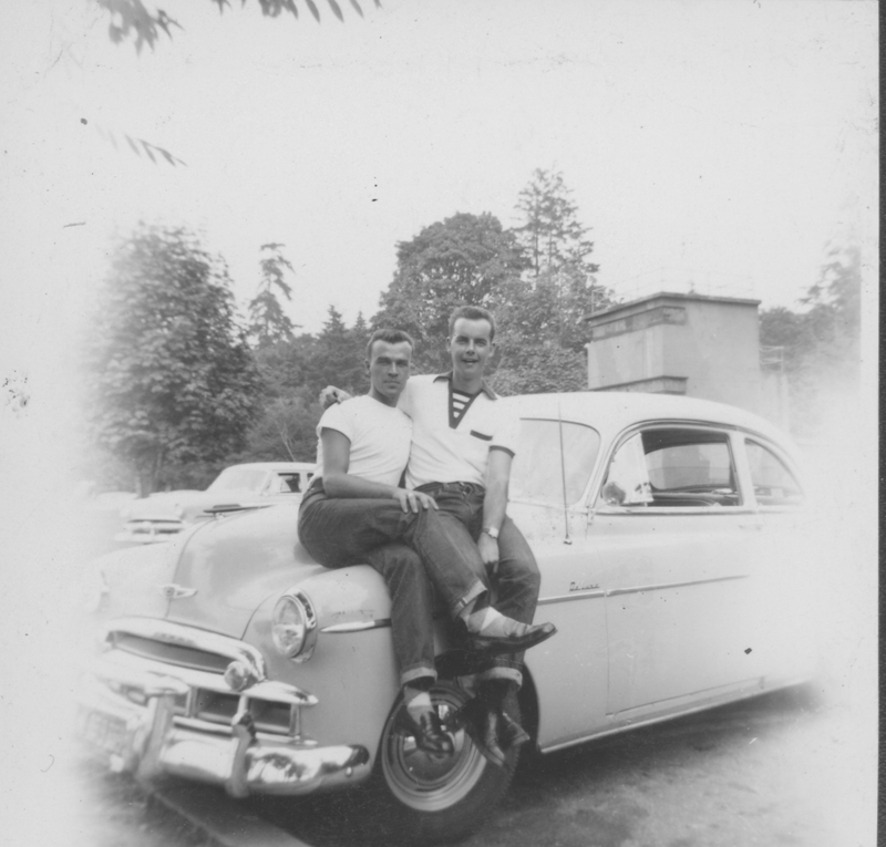 J. J. Belanger (left) and Daryl Mutz on the hood of a car in Stanley Park, Vancouver. September 1953.
