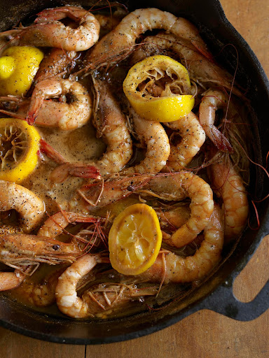 Bar B Q Shrimp cooked on a sizzling iron skillet is a staple of Louisiana cuisine. (Martha Stewart Living)