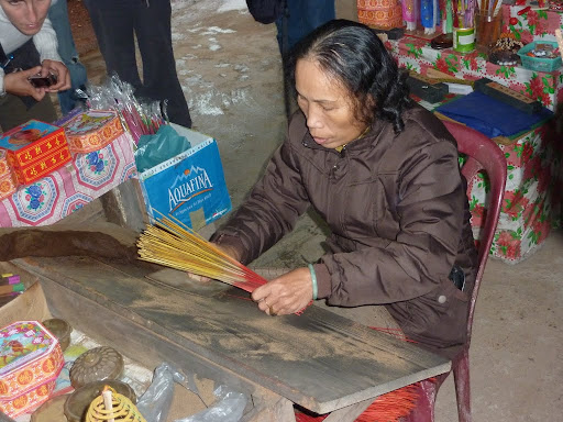 A local demonstration of how to make incense sticks, and then sell them to you.