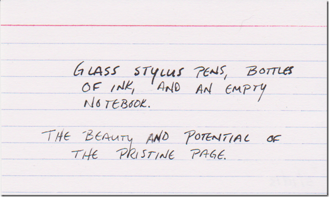 Glass stylus pens, bottles of ink, and an empty notebook. The beauty and potential of the pristine page.
