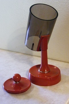 Orange plastic Dixie cup dispenser