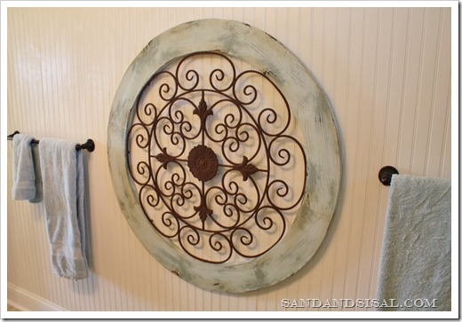 Garden medallion on bead board wall