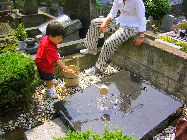 Kai cleaning the Toyoda family tomb