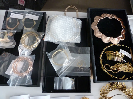 A few trays of jewelry and accessories including a Jennifer Behr haircomb and Jennifer Fisher bracelets (on the left).