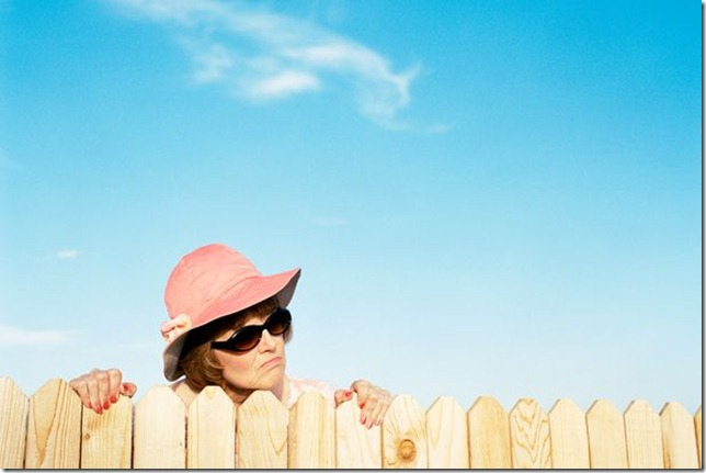 Mature-woman-looking-over-fence