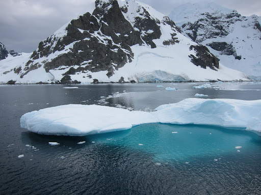 Tip of the iceberg - notice the large, darker-colored mass visible through the water.