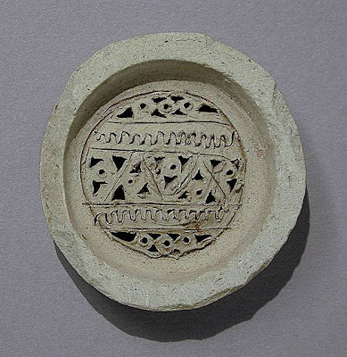 Jar Filter Western or Central Iran Jar Filter Ceramic; Vessel, Terracotta, Height: 9/16 in. (1.4 cm); Diameter: 2 5/16 in. (5.8 cm) Gift of Jerome F. Snyder (M.80.202.229) Art of the Middle East: Islamic Department.
