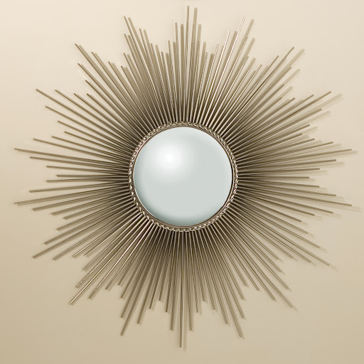 It's essential to have a mirror in your entryway. That way you can quickly check your appearance before running out the door. I like this sunburst mirror because it doubles as wall art. (rejuvenation.com)