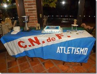 Bandera trofeo y torta