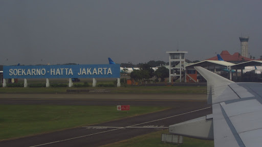 Arriving at Jakarta's airport following a quick flight from Singapore.