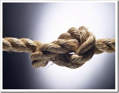 brown-fiber-rope-knot-in-spotlight