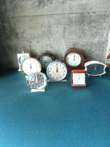 Brown Paper Designs brought a selection of old clocks, which were set up on the high-boy tables around the bar. They were set to midnight in honor of the holiday.