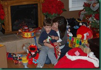 mom and jake opening gifts