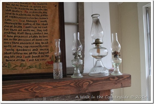 mantel decorated with religious items and oil lamps