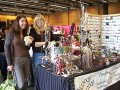 A zealous attendee posing with fantastic jewelry maker at Thread Show Seattle