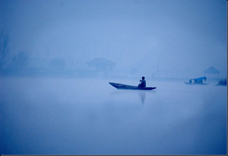 A Kashmiri man paddles to a floating market in the early freezing temperatures before sunrise on Dal Lake in the summer capital of Kashmir, Srinagar India, November 24. In the background, echoing through the nearby mountains, gunshots and fighting could be heard. Kashmir was once a tourist hotspot but now vendors struggle to survive in a place that has seen nearly 1000 civilians killed this year alone and 1,765 wounded in a brutal conflict that the United Nations calls the most dangerous place in the world.