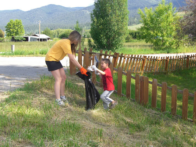 Run Wild Missoula Director Eva Dunn-Froebig and her son, Milo, clean up the Missoula Marathon course.