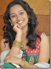 Indu Thampi beautiful smile