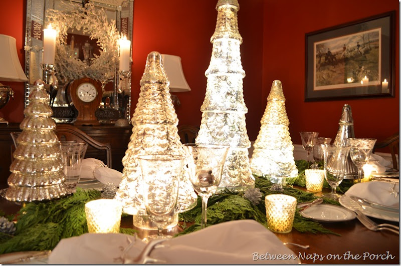 A mercury glass christmas tree table setting tablescape