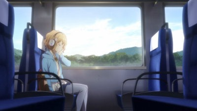 Ohana dozes sitting in a passenger train